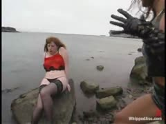 Kym punishes Neeka at pier, strip, verbal, whipping outdoors