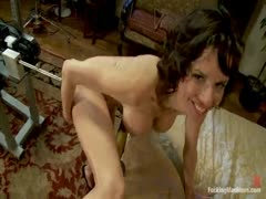 Squirting MILF pinup hottie cums hard from hooked black dong going mach 4 on a fucking machine. She squirts down her toned legs while doing the splits