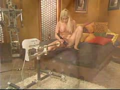 Horny Blonde gets worked over by Fuckzilla in Fuckingmachines.
