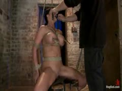 Bound in a chair with a vibrator perfectly stuck on her clit
