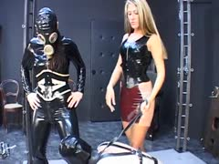 Cruel blonde governess tormenting a slave