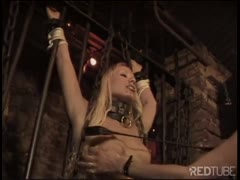 BDSM extreme scene in the dungeon