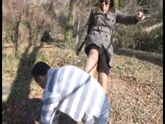 Outdoor cock trampling punishment from an angry girlfriend