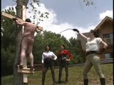Pony boy tied into a croos outdoor and gets punished