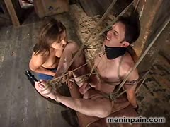 Brutally sadistic mistress torturing a tied up slave