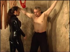 Powerless man punished by latex wicked mistress
