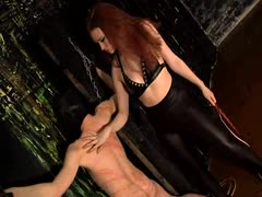 Poor slave receives intense whipping from a violent redhead