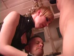 Cruel blonde domina in tight latex forcing a guy to suck cock