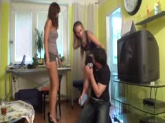 Loser guy takes some humiliating treatment from two femdom chicks