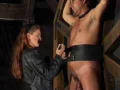 Dungeon bound slaves toyed by a ruthless mistress