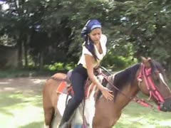 Horse back riding by a playful femdom