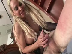 Busty MILF playing cock of a tied slave