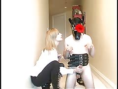 Maitresse Madeline with her gas mask male servant