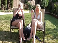 Two  smoking blondes outdoors