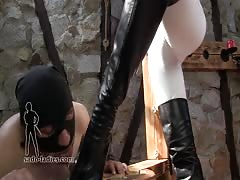 Using her boots to punish him