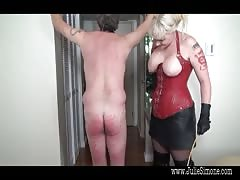 Busty domme giving pain to slaves ass