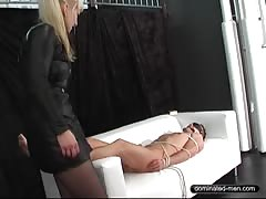 Blonde dominatrix smothers  her ted slave in the couch