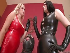 Dominant mistress in red and black latex