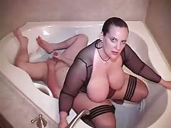 Huge ass on slave's afce in the bath tub