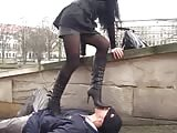 Trampling with black high heel boots