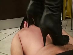 Busty domme trampling in black boots