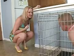 Cage foot worshiper in the kitchen