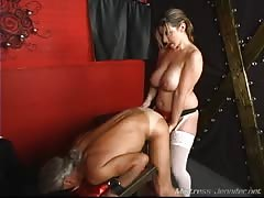 Big boobed woman with strapon pegs her slave
