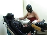 Rough hardcore pegging to a latex male slave