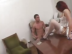 Naughty woman pegging in the office