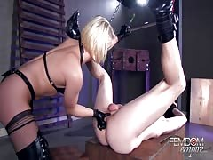 Tied and pegged by short haired blonde mistress