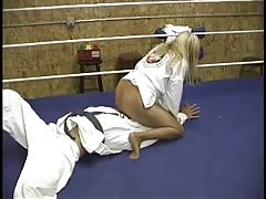 Dominates a man in mixed judo and wrestling